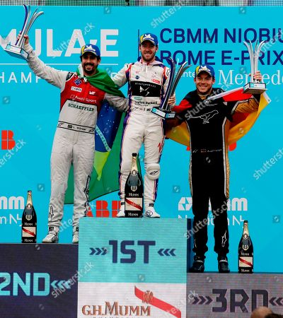 DS Virgin Racing team driver Sam Bird, center, is flanked by second placed Audi Sport ABT Schaeffler team Lucas Di Grassi, left, and third placed Techeetah team driver Andre Lotterer during the podium ceremony of the Formula E Rome E-Prix auto competition in Rome