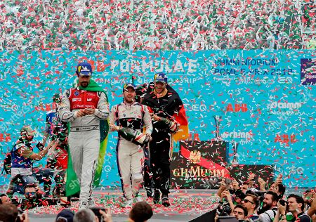 First placed DS Virgin Racing team driver Sam Bird, center, is flanked by second placed Audi Sport ABT Schaeffler team Lucas Di Grassi, left, and third placed Techeetah team driver Andre Lotterer during the podium ceremony of the Formula E Rome E-Prix auto competition in Rome