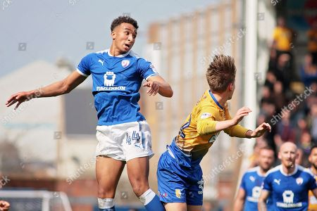 Chesterfield forward Jacob Brown (44) clears with this header during the EFL Sky Bet League 2 match between Chesterfield and Mansfield Town at the Proact stadium, Chesterfield, England on 14 A pril 2018. Picture by Nigel Cole