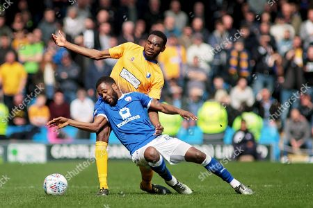 Mansfield Town defender Hayden White (16) and Chesterfield midfielder Zavon Hines (41) battle for the ball during the EFL Sky Bet League 2 match between Chesterfield and Mansfield Town at the Proact stadium, Chesterfield, England on 14 A pril 2018. Picture by Nigel Cole