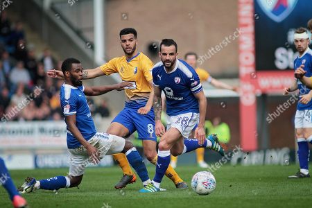 Mansfield Town midfielder Jacob Mellis (8) slips the ball past Chesterfield midfielder Robbie Weir (28) during the EFL Sky Bet League 2 match between Chesterfield and Mansfield Town at the Proact stadium, Chesterfield, England on 14 A pril 2018. Picture by Nigel Cole