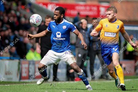 Stock Photo of Chesterfield midfielder Zavon Hines (41)  shields the ball from Mansfield Town midfielder Alfie Potter (17) during the EFL Sky Bet League 2 match between Chesterfield and Mansfield Town at the Proact stadium, Chesterfield, England on 14 A pril 2018. Picture by Nigel Cole
