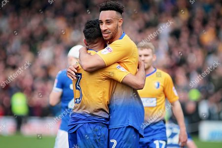 Mansfield Town defender Rhys Bennett (2) and Mansfield Town defender Malvind Benning (3) celebrate after the final whistle after the EFL Sky Bet League 2 match between Chesterfield and Mansfield Town at the Proact stadium, Chesterfield, England on 14 A pril 2018. Picture by Nigel Cole