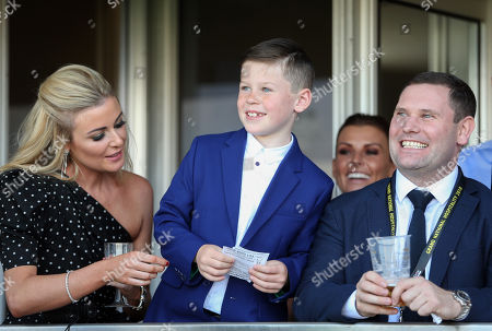 Kai Rooney smiles as he watches the Gaskells Handicap Hurdle