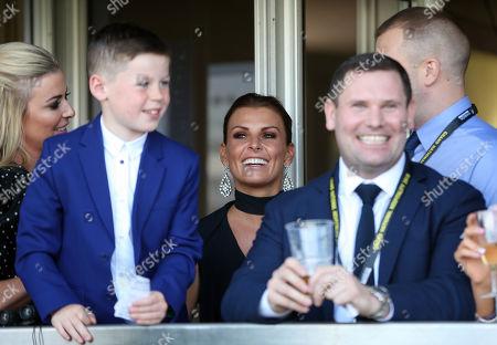 Coleen Rooney smiles during the Gaskells Handicap Hurdle
