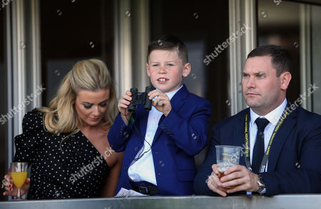 Stock Photo of Kai Rooney smiles as he watches the Gaskells Handicap Hurdle