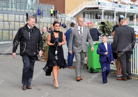Coleen Rooney arrives at the racecourse with her son Kai