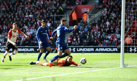 Eden Hazard,  of Chelsea collects the ball after Alex McCarthy, of Southampton, fumbles.