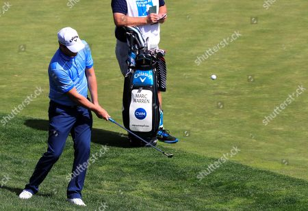 Marc Warren of Scotland hits the ball during the third day of Madrid Open golf tournament at the National Golf Course in Madrid, Spain, 14 April 2018.