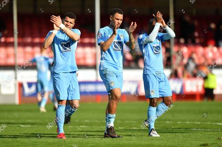 L-R; Coventry City players Maxime Biamou, Jonson Clarke-Harris and Kyle Reid celebrate victory over Crawley during the EFL Sky Bet League 2 match between Crawley Town and Coventry City at the Checkatrade.com Stadium, Crawley. Picture by Alistair Wilson