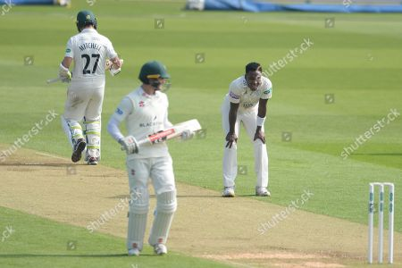 Fidel Edwards with his hands on his knees as Daryl Mitchell and Josh Tounge take a run during the Specsavers County Champ Div 1 match between Hampshire County Cricket Club and Worcestershire County Cricket Club at the Ageas Bowl, Southampton. Picture by Dave Vokes