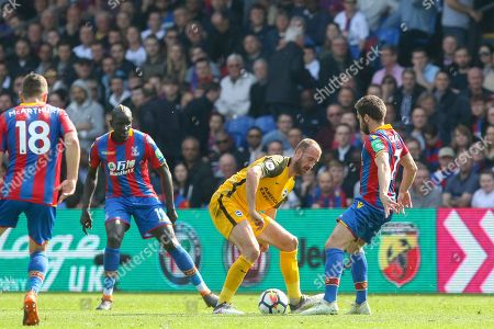 Brighton and Hove Albion forward Glenn Murray (17) battles with Crystal Palace #7 Yohan Cabaye during the Premier League match between Crystal Palace and Brighton and Hove Albion at Selhurst Park, London. Picture by Phil Duncan