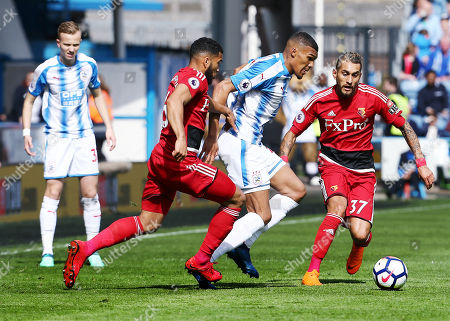 Collin Quaner of Huddersfield Town and Adrian Mariappa of Watford