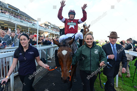 AINTREE. Randox Health Grand National. TIGER ROLL and Davy Russell are led in by grooms Louise Dunne (right) and Karen Morgan after their win for owner Gigginstown Stud and trainer Gordon Elliott.