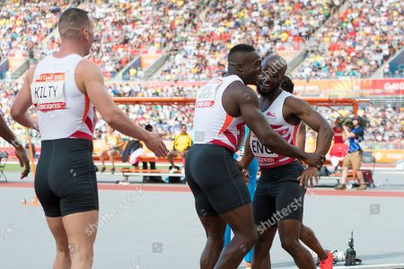 Harry Aikines-Aryeetey (ENG), Richard Kilty (ENG) and Reuben Arthur (ENG) happy after winning at The Commonwealth Games, mens 4 x 100m Relay Running Final at Carrara Stadium on The Gold Coast.