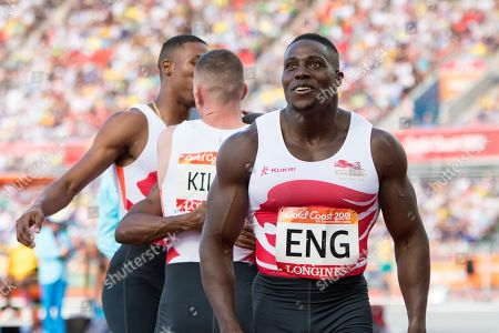 Harry Aikines-Aryeetey (ENG), Richard Kilty (ENG) and Reuben Arthur (ENG) and Zharnel Hughes (ENG) happy after winning at The Commonwealth Games, mens 4 x 100m Relay Running Final at Carrara Stadium on The Gold Coast.