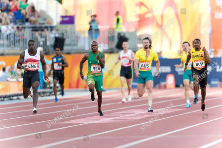 Harry Aikines-Aryeetey (ENG) holds out Akani Simbine (RSA) to give England the gold medal at The Commonwealth Games, mens 4 x 100m Relay Running Final at Carrara Stadium on The Gold Coast.