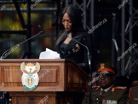British model Naomi Campbell is overcome with emotion as she pays a tribute to anti-apartheid activist Winnie Madikizela-Mandela during her funeral ceremony at Soweto's Orlando stadium . Madikizela-Mandela died April 2, 2018, at the age of 81