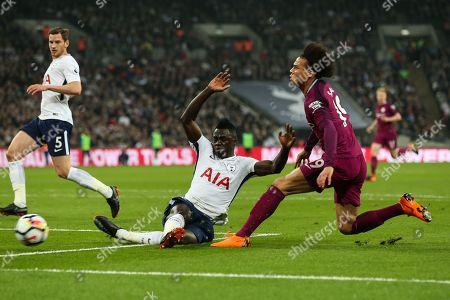 Tottenham Hotspur defender Davinson Sanchez (6) slide tackles Manchester City midfielder Leroy Sane (19) during the Premier League match between Tottenham Hotspur and Manchester City at Wembley Stadium, London. Picture by Toyin Oshodi