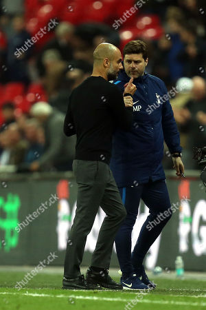 Tottenham manager Mauricio Pochettino and Manchester City manager Josep (Pep) Guardiola after Tottenham Hotspur vs Manchester City, Premier League Football at Wembley Stadium on 14th April 2018