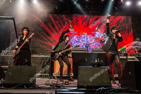 Heath, Richard Fortus, Sugizo. Heath, from left, Richard Fortus of Guns N' Roses, and Sugizo of X Japan performs at the Coachella Music & Arts Festival at the Empire Polo Club, in Indio, Calif