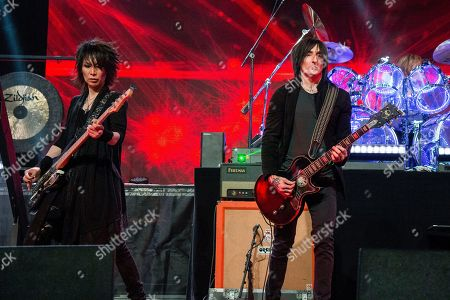 Heath, Richard Fortus, Toshi, Sugizo. Heath, from left, Richard Fortus of Guns N Roses, Toshi and Sugizo of X Japan performs at the Coachella Music & Arts Festival at the Empire Polo Club, in Indio, Calif