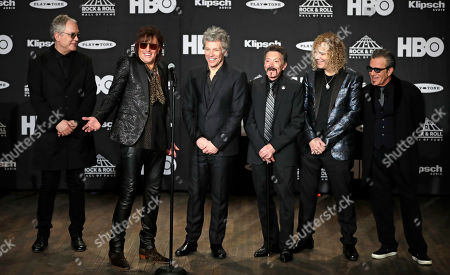 Members of the Bon Jovi band answer questions during the Rock and Roll Hall of Fame Induction ceremony, in Cleveland
