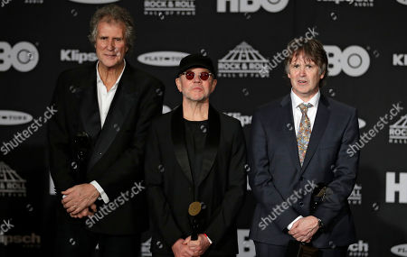 John Illsley, Alan Clark, Guy Fletcher. John Illsley, left to right, Alan Clark and Guy Fletcher, members of Dire Straits, answer questions during the Rock and Roll Hall of Fame Induction ceremony, in Cleveland