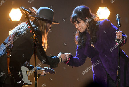Jerry Cantrell, Ann Wilson. Jerry Cantrell, left, and Ann Wilson bump fists after performing during the Rock and Roll Hall of Fame Induction ceremony, in Cleveland