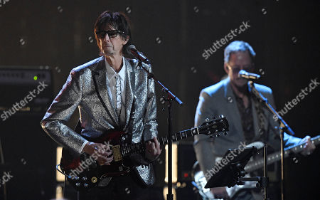 Ric Ocasek, left, from the Cars, performs during the Rock and Roll Hall of Fame induction ceremony, in Cleveland