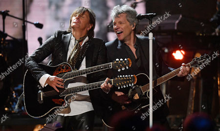 Richie Sambora, Jon Bon Jovi. Richie Sambora, left, and Jon Bon Jovi perform during the Rock and Roll Hall of Fame induction ceremony, in Cleveland