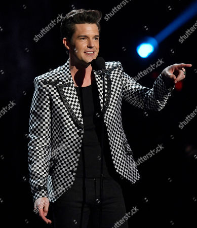 Brandon Flowers, from the band The Killers, speaks during the Rock and Roll Hall of Fame induction ceremony, in Cleveland