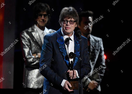 Elliot Easton of the Cars speaks during the Rock and Roll Hall of Fame induction ceremony, in Cleveland