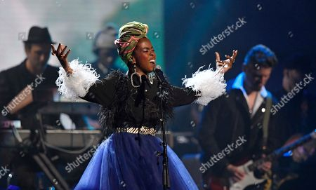 Recording artist Lauryn Hill pays tribute to Nina Simone during the Rock and Roll Hall of Fame induction ceremony, in Cleveland