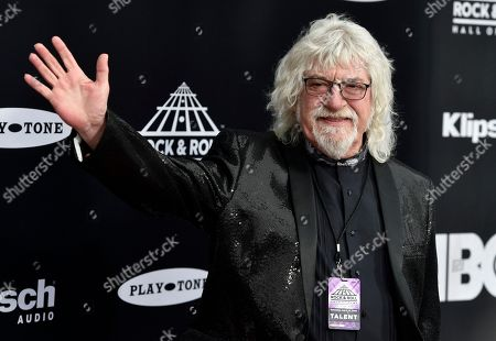 Graeme Edge, drummer for the Moody Blues, waves on the red carpet before the Rock and Roll Hall of Fame Induction ceremony, in Cleveland