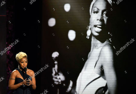 Presenter Mary J. Blige honors Nina Simone during the Rock and Roll Hall of Fame induction ceremony, in Cleveland