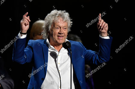 John Lodge, bassist for the Moody Blues, speaks during the Rock and Roll Hall of Fame induction ceremony, in Cleveland