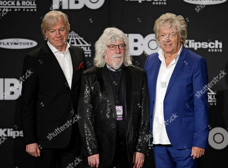 Justin Hayward, Graeme Edge, John Lodge, members of the Moody Blues, answer questions before the Rock and Roll Hall of Fame induction ceremony, in Cleveland