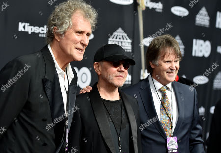 John Illsley, Alan Clark, Guy Fletcher. John Illsley, left to right, Alan Clark and Guy Fletcher, members of Dire Straits, arrive at the red carpet before the Rock and Roll Hall of Fame induction ceremony, in Cleveland