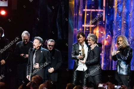 Jon Bon Jovi, Tico Torres, Hugh McDonald, Richie Sambora, David Bryan. Hugh McDonald, left, Tico Torres, Richie Sambora, Jon Bon Jovi and David Bryan are seen at the 2018 Rock and Roll Hall of Fame Induction Ceremony at Cleveland Public Auditorium, in Cleveland, Ohio
