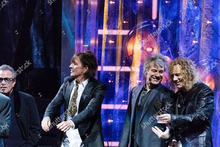 Jon Bon Jovi, Tico Torres, Richie Sambora, David Bryan. Tico Torres, left, Richie Sambora, Jon Bon Jovi and David Bryan are seen at the 2018 Rock and Roll Hall of Fame Induction Ceremony at Cleveland Public Auditorium, in Cleveland, Ohio