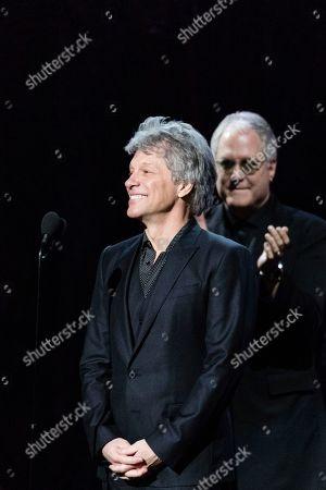 Jon Bon Jovi, Hugh Mcdonald. Jon Bon Jovi, left, and Hugh McDonald are seen at the 2018 Rock and Roll Hall of Fame Induction Ceremony at Cleveland Public Auditorium, in Cleveland, Ohio
