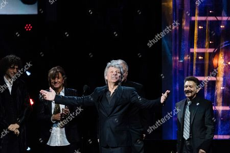 Richie Sambora, Jon Bon Jovi, Howard Stern, Tico Torres. Howard Stern, left, Richie Sambora, Jon Bon Jovi, and Tico Torres are seen at the 2018 Rock and Roll Hall of Fame Induction Ceremony at Cleveland Public Auditorium, in Cleveland, Ohio