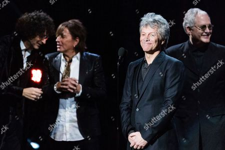 Richie Sambora, Jon Bon Jovi, Howard Stern, Hugh Mcdonald. Howard Stern, left, Richie Sambora, Jon Bon Jovi, and Hugh McDonald and are seen at the 2018 Rock and Roll Hall of Fame Induction Ceremony at Cleveland Public Auditorium, in Cleveland, Ohio