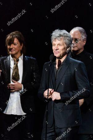 Richie Sambora, Jon Bon Jovi, Hugh Mcdonald. Richie Sambora, let, Jon Bon Jovi, and Hugh McDonald, are seen at the 2018 Rock and Roll Hall of Fame Induction Ceremony at Cleveland Public Auditorium, in Cleveland, Ohio