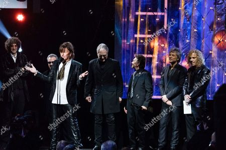 Richie Sambora, Hugh McDonald, Jon Bon Jovi, David Bryan, Howard Stern, Tico Torres. Howard Stern, left, Richie Sambora, Hugh McDonald, Tico Torres, Jon Bon Jovi, and David Bryan are seen at the 2018 Rock and Roll Hall of Fame Induction Ceremony at Cleveland Public Auditorium, in Cleveland, Ohio