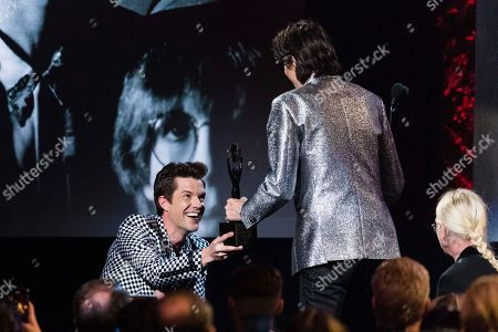 Birttany Howard, Ric Ocasek. Brandon Flowers, left, and Ric Ocasek are seen at the 2018 Rock and Roll Hall of Fame Induction Ceremony at Cleveland Public Auditorium, in Cleveland, Ohio