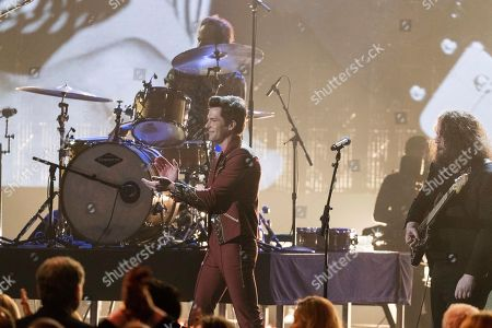 Brandon Flowers, Zac Cockrell. Brandon Flowers, left, and Zac Cockrell perform at the 2018 Rock and Roll Hall of Fame Induction Ceremony at Cleveland Public Auditorium, in Cleveland