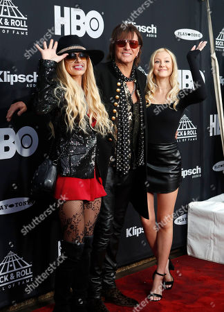 Stock Image of Ava Sambora (R), Richie Sambora (C) of Bon Jovi and Orianthi (L) arrive at the Rock and Roll Hall of Fame induction ceremony at Public Hall in Cleveland, Ohio, USA, 14 April, 2018. This year's inductees to the Rock and Roll Hall of Fame are:  Bon Jovi, The Moody Blues, The Cars, Dire Straits, Nina Simone, and Sister Rosetta Tharpe.