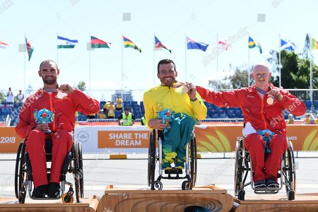 (L-R) Silver medalist John Smith of England, gold medalist Kurt Fearnley of Australia and bronze medalist Simon Lawson of England pose for photographers on the awards podium during the medal ceremony for the T54 Marathon during the XXI Commonwealth Games on the Gold Coast, Queensland, Australia, 15 April 2018.